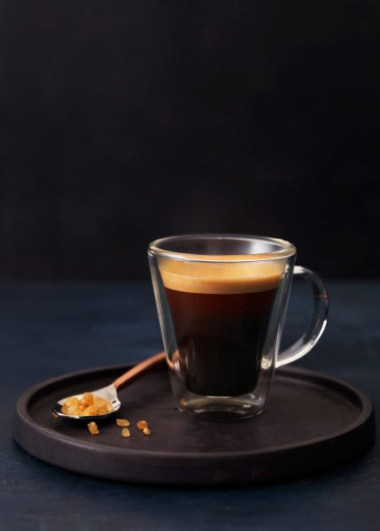 styled coffee espresso shot on dark background shallow dof with sugar drink photographer london bratislava