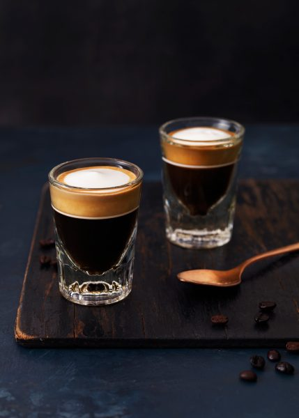 two shots of macchiato on dark background with spoon and sugar drink photographer fotograf drinkov london bratislava