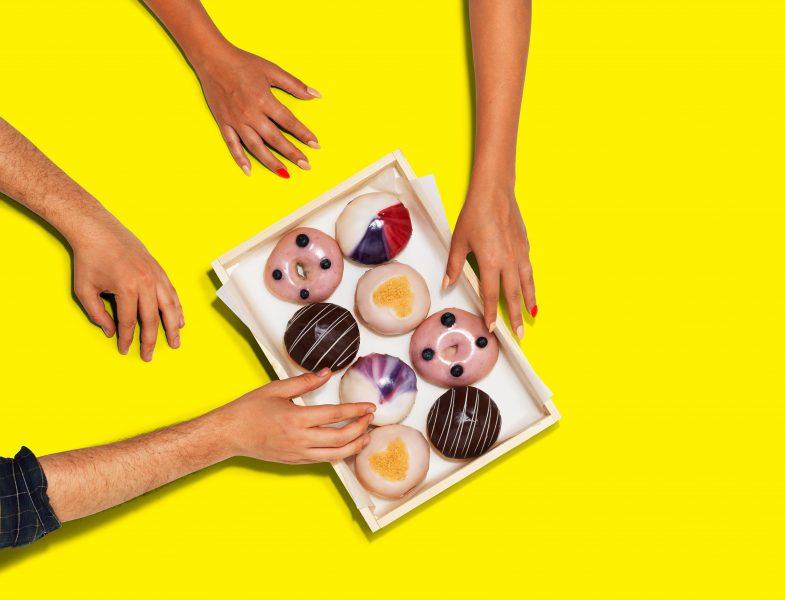 hands-grabbing-doughnuts-city-pantry-advert